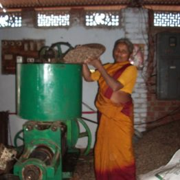 Shammamma heads a women's collective that has created a factory that presses oil from neem seeds for sale as an organic pesticide.