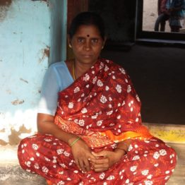 In a fishing village struck by the Tsunami Nagamma has taken a loan to repair her husband's fishing net.